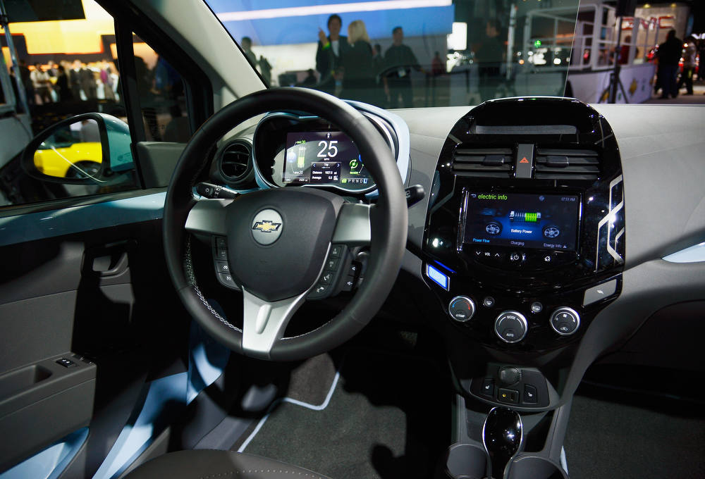 . LOS ANGELES, CA - NOVEMBER 28:  The new 2014 Chevy Spark EV electric vehicle is unveiled during the Los Angeles Auto show on November 28, 2012 in Los Angeles, California. The LA Auto Show opens to the public November 30 and runs through December 9.  (Photo by Kevork Djansezian/Getty Images)