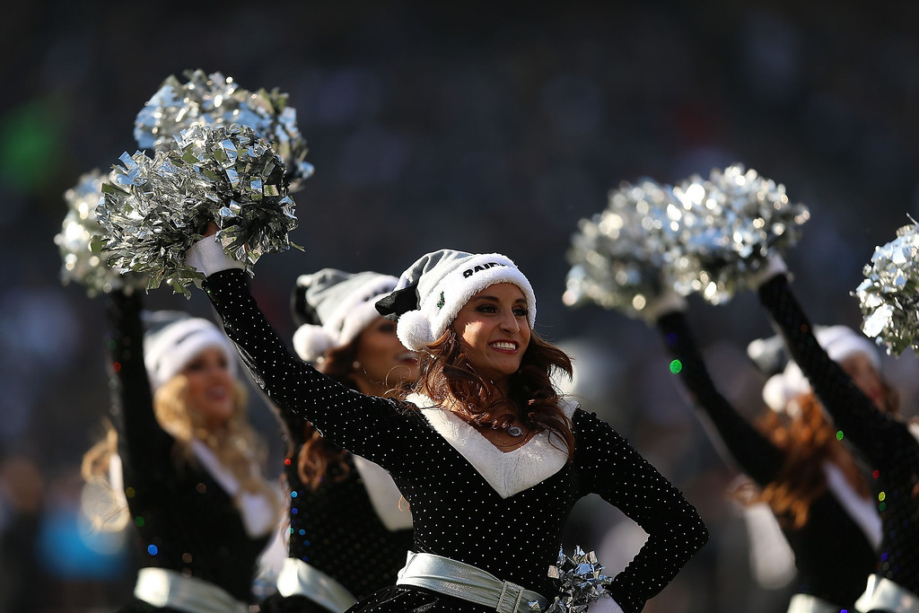 . Cheerleaders of the Oakland Raiders perform against the Kansas City Chiefs at O.co Coliseum on December 15, 2013 in Oakland, California.  (Photo by Jed Jacobsohn/Getty Images)
