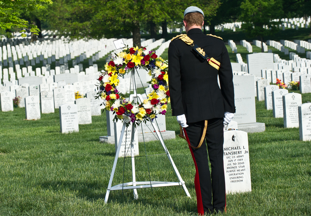 . Prince Harry of Great Britain, wearing his British Army ceremonial uniform of the Blues And Royals in his role as Captain Harry Wales, lays a wreath at Section 60 of Arlington National Cemetery, where veterans of the wars in Iraq and Afghanistan are buried, on May 10, 2013 in Arlington Virginia. During his visit to the US, Prince Harry will be undertaking engagements on behalf of charities with which he is closely associated, on behalf also of HM Government, with a central theme of supporting injured service personnel from the UK and US forces.  (Photo by Nicholas Kamm - Pool/Getty Images)