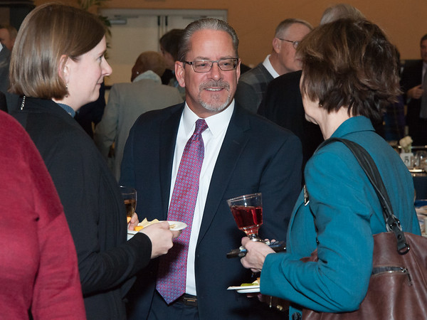 11/15/18 Wesley Bunnell | Staff The Greater New Britain Chamber of Commerce held their 105th Annual Meeting on Thursday night at CCSU. Chamber President Tim Stewart talks with guests.