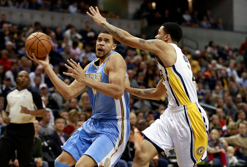 . Denver Nuggets center JaVale McGee (L) moves toward the basket defended by Indiana Pacers forward Gerald Green (R) during the first quarter of an NBA basketball game in Indianapolis, Indiana December 7, 2012.  REUTERS/Brent Smith (
