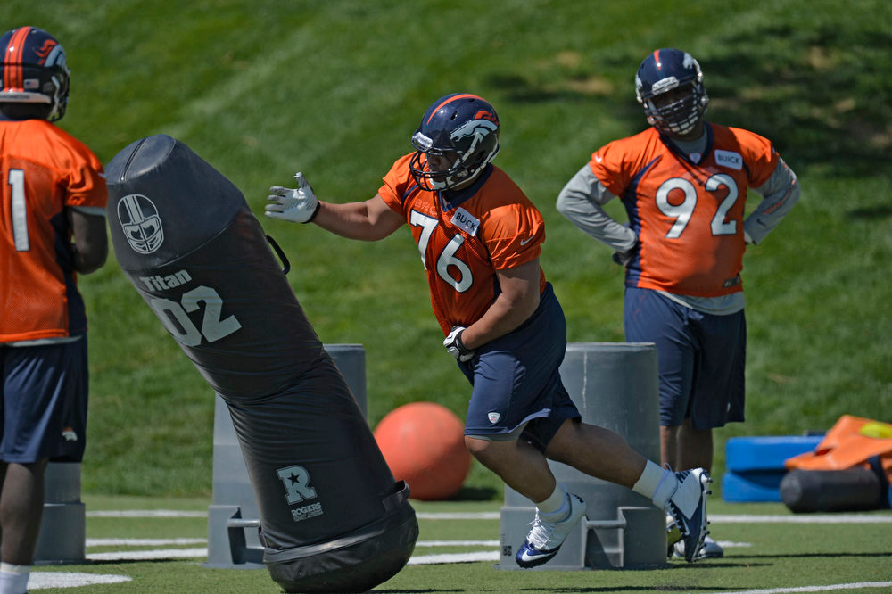 . Romney Fuga (76) of the Denver Broncos runs through drills during the last day of rookie mini camp May 12, 20313 at Dover Valley.   (Photo By John Leyba/The Denver Post)