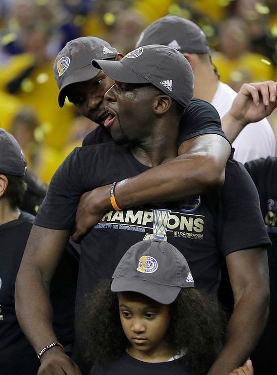 . Golden State Warriors forward Kevin Durant, rear, and forward Draymond Green celebrate after Game 5 of basketball\'s NBA Finals against the Cleveland Cavaliers in Oakland, Calif., Monday, June 12, 2017. The Warriors won 129-120 to win the NBA championship. (AP Photo/Marcio Jose Sanchez)