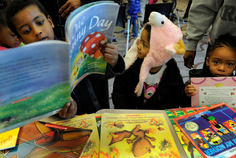 . After the reading, Students from Real Kids Preschool from left to right, Sedik Mote, 4, Dawenise Burks, 3, and Nyimah Bryant, 2, each get to pick out their own book to take home. Denver singer Hazel Miller joins local pre-school and kindergarten children at the Blair Caldwell Library on Friday, Feb. 10, 2012 to help celebrate Black History Month by reading several books and singing a few songs. Clifford the Big Red Dog and Winnie the Pooh were also there to entertain the kids. Kathryn Scott Osler, The Denver Post