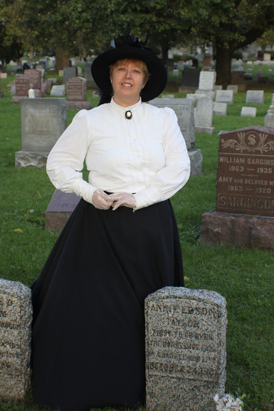 Annie Edson Taylor by her grave at Oakwood Cemetery, Niagara Falls, NY.