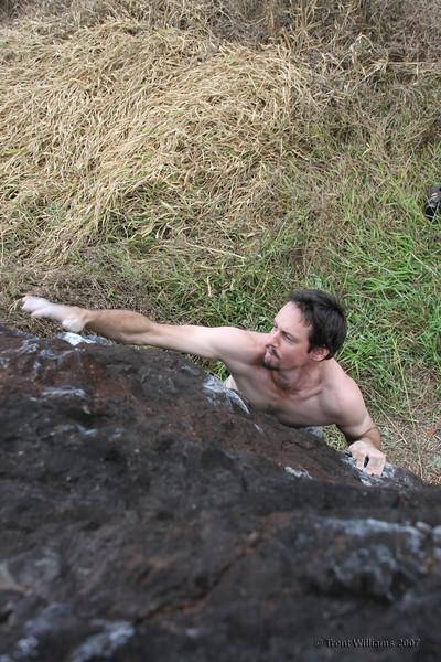 Craig bouldering at Nerada Rocks, Innisfail. He's climbing Tupperware Party (V2)
