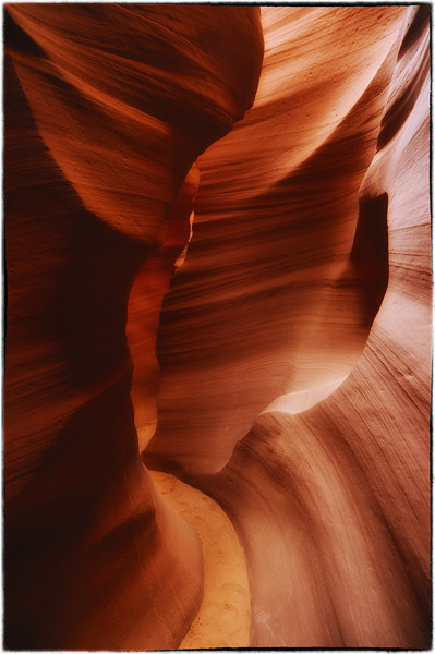 "I just returned from Arizona and had a chance to visit a very beautiful place called Antelope Canyon. Antelope Canyon is called Tsé bighánílíní, ""the place where water runs through rocks"" by the Navajo and the formations under the ground are some of the most beautiful you will see.  The canyon is deep but it still allows for lots of natural sunlight to come through the slots.  That makes this a more beautiful place than many caves that I have visited which are lit up by a variety of colored lights.  All the light in this canyon is natural which makes it the most beautiful to photograph.  There are two canyons, Upper and Lower Antelope Valley.  The Upper canyon is very famous for light beams that shoot from directly above into the canyon and make for some marvelous photos.  The lower canyon which I had basically to myself for 2 hours is a more difficult and narrow canyon than upper canyon and does not have the same light beams.  People usually come to this place during the summer months because the sun is literally overhead and provides the most dramatic light into the canyons.  That's probably why I had this place to myself."