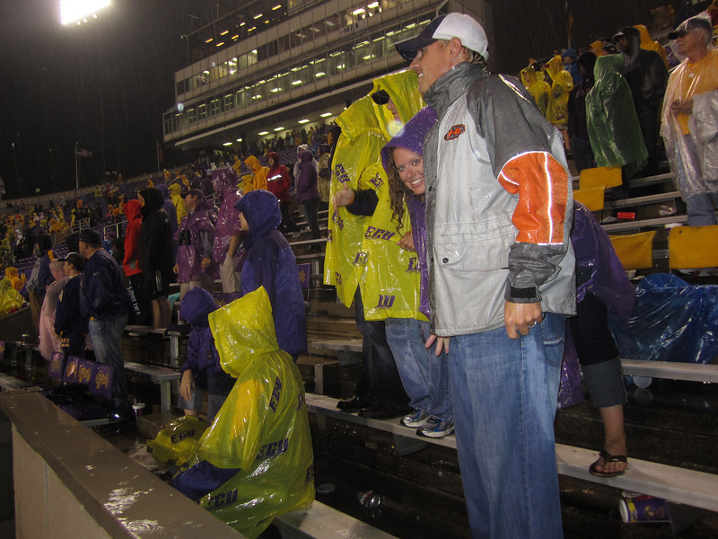 9/29 UTEP Watching the game in the rain in the 4th. Lauren, JG
