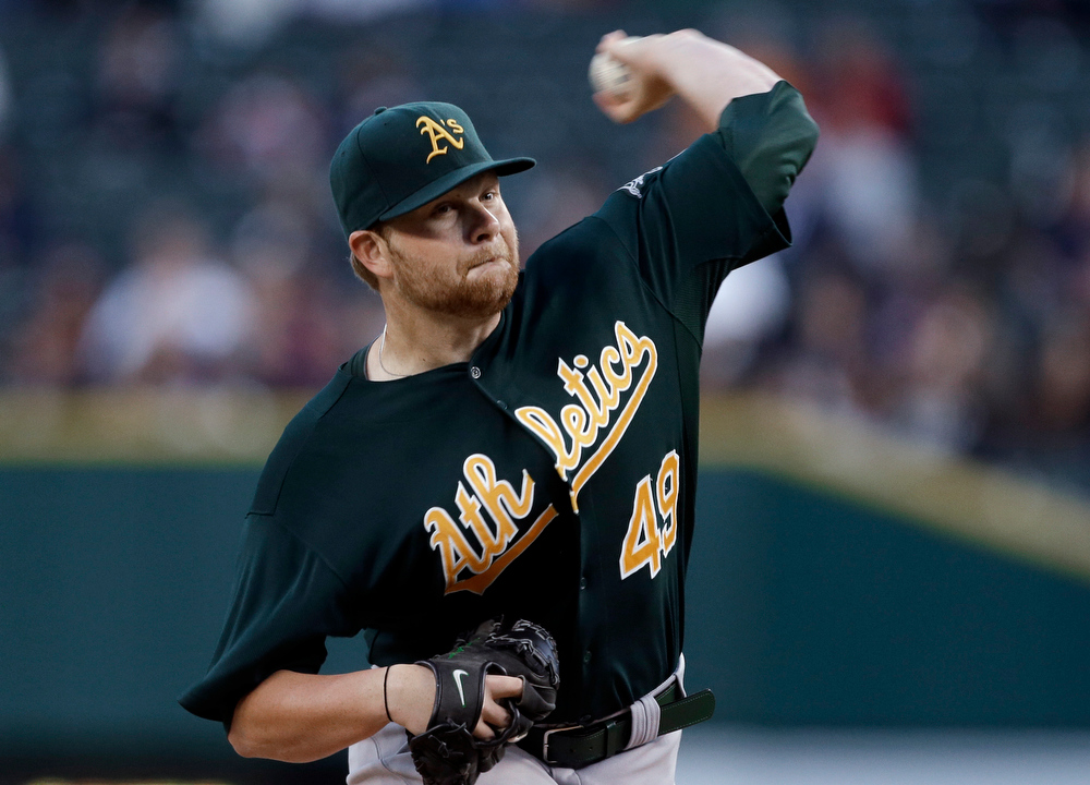 . Oakland Athletics starting pitcher Brett Anderson throws to a Detroit Tigers batter during the first inning of a baseball game in Detroit, Wednesday, Sept. 19, 2012. (AP Photo/Paul Sancya)