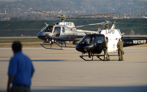 . ON13-MANHUNT-05-JCM (Jennifer Cappuccio Maher/Staff Photographer) Various police agencies stage at San Bernardino International Airport Tuesday, February 12, 2013, in San Bernardino. A man believed to be fired LAPD officer Christopher Dorner barricaded himself in a cabin in the San Bernardino Mountains.