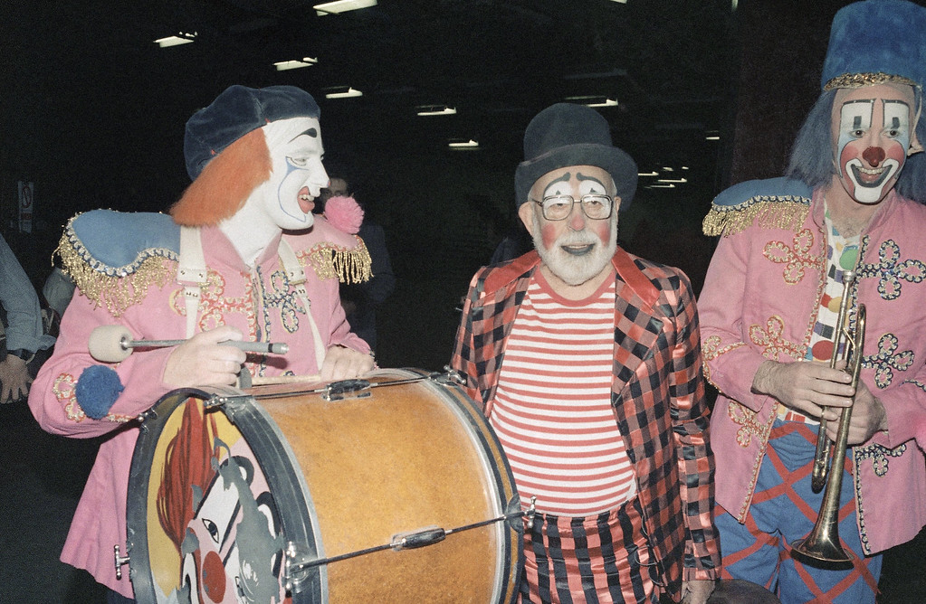 ". Stanley Marcus of Neiman-Marcus department stores participates in Ringling Brothers and Barnum and Bailey Circus dressed as a clown at Madison Square Garden, New York, April 28, 1985. This was arranged as an 80th birthday present by friends of Mr. Marcus who had told them he always wanted to ""run away and join the circus\"". (AP Photo/Nancy Kaye)"
