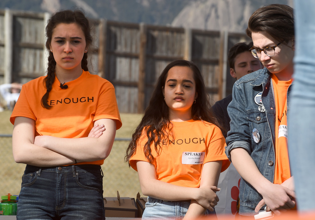 . Edden Rosenberg, left, Ayeska Rawal, and Henry Magowan, listen to the stories of the Parkland, FL students at Fairview High School in Boulder. Students at schools across Boulder County and Broomfield walked out of class around 10 this morning as they took part in the nationwide protest of gun violence on the one-month anniversary of the massacre at a high school in Parkland, Fla., that left 17 dead. Cliff Grassmick  Photographer  March 14, 2018