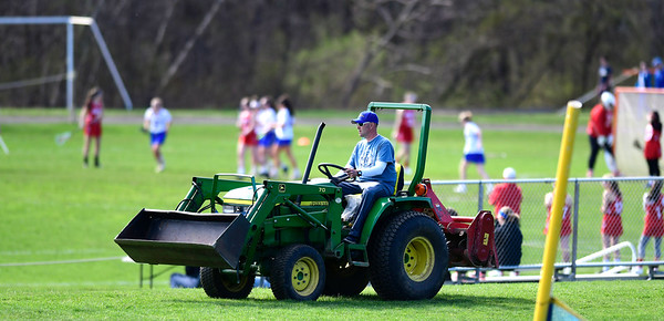 4/17/2019 Mike Orazzi | Staff David Dennehy works the grounds during Wednesday's game in Bristol.