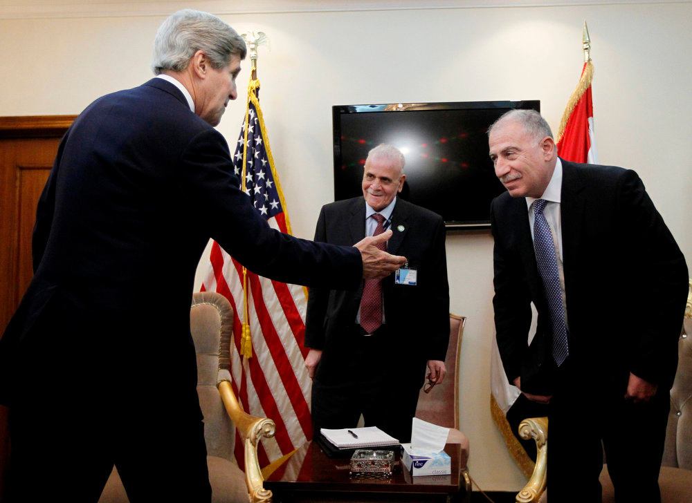 . U.S. Secretary of State John Kerry, left, meets with Iraq\'s Parliament Speaker Osama al-Nujaifi, right, in Baghdad, Iraq, Sunday, March 24, 2013. Kerry made an unannounced visit to Iraq on Sunday and will urge al-Maliki to make sure Iranian flights over Iraq do not carry arms and fighters to Syria, a U.S. official said.  (AP Photo/Jason Reed, Pool)