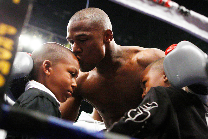 . Floyd Mayweather Jr. kisses his son before his WBC welterweight boxing title fight versus Ricky Hatton, of Great Britain, at the MGM Grand hotel-casino in Las Vegas, Saturday, Dec. 8, 2007. (AP Photo/Isaac Brekken)