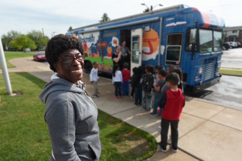 Foster Grandparent Leotha Letang follows kids to the bookmobile during the Washtenaw County Foster Grandparent Program at Perry Early Learning Center in Ypsilanti, Michigan.  (Photo by Mark Bialek)