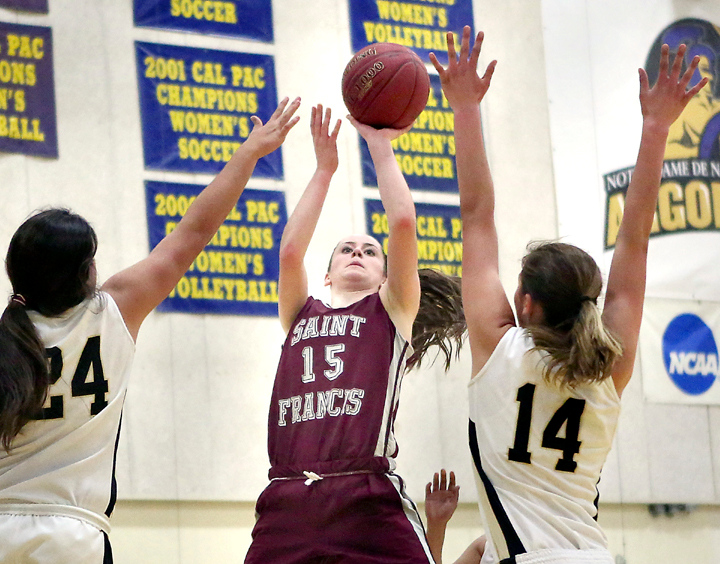. St. Francis Senior Lauren Price (15) shoots between two PCS players during the second half of the CCS Division V Girls Basketball Championship game on Friday night at Notre Dame de Namur University in Belmont. (Kevin Johnson/Sentinel)