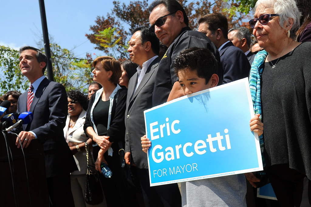 . Sebastian Barreras holds a sign while attending Eric Garcetti\'s press conference at El Centro del Pueblo in Echo Park, CA May 22, 2013.  Eric Garcetti won the mayoral runoff Tuesday in Los Angeles.(Andy Holzman/Staff Photographer)