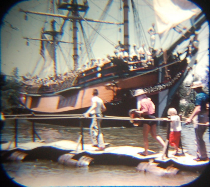 1959 Viewmaster of Columbia passing the pontoon bridge on Tom Sawyer's Island. Note the single rope railing on the bridge.