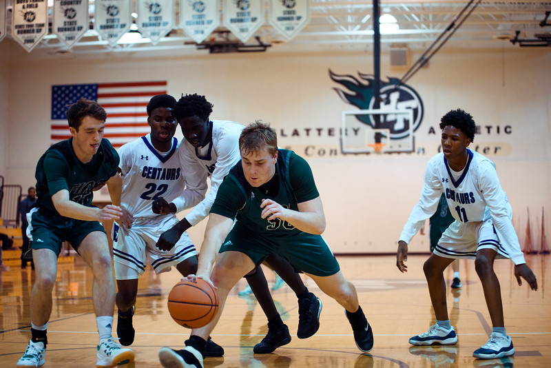 Holy Family Boys Varsity Basketball vs. Brooklyn Center, 12/5/19: Seth Thompson '20 (50)