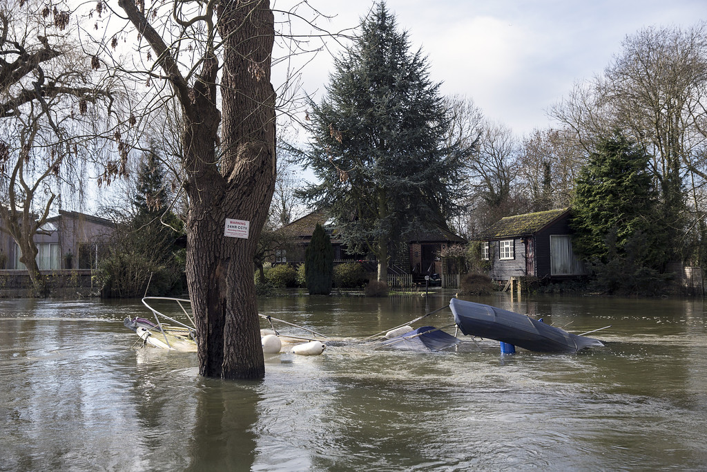 . A motorboat lies submerged in the River Loddon, surrounded by flood water on February 13, 2014 in Wargrave, England. (Photo by Oli Scarff/Getty Images)