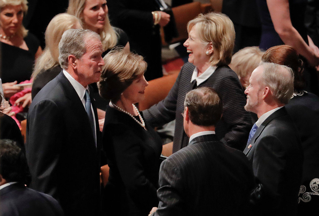 . Former President George W. Bush, left, former first lady Laura Bush, Center, and former Secretary of State Hillary Clinton, right, arrive with other dignitaries and invited guests to attend a memorial service for Sen. John McCain, R-Ariz., at Washington National Cathedral in Washington, Saturday, Sept. 1, 2018. McCain died Aug. 25, from brain cancer at age 81. (AP Photo/Pablo Martinez Monsivais)