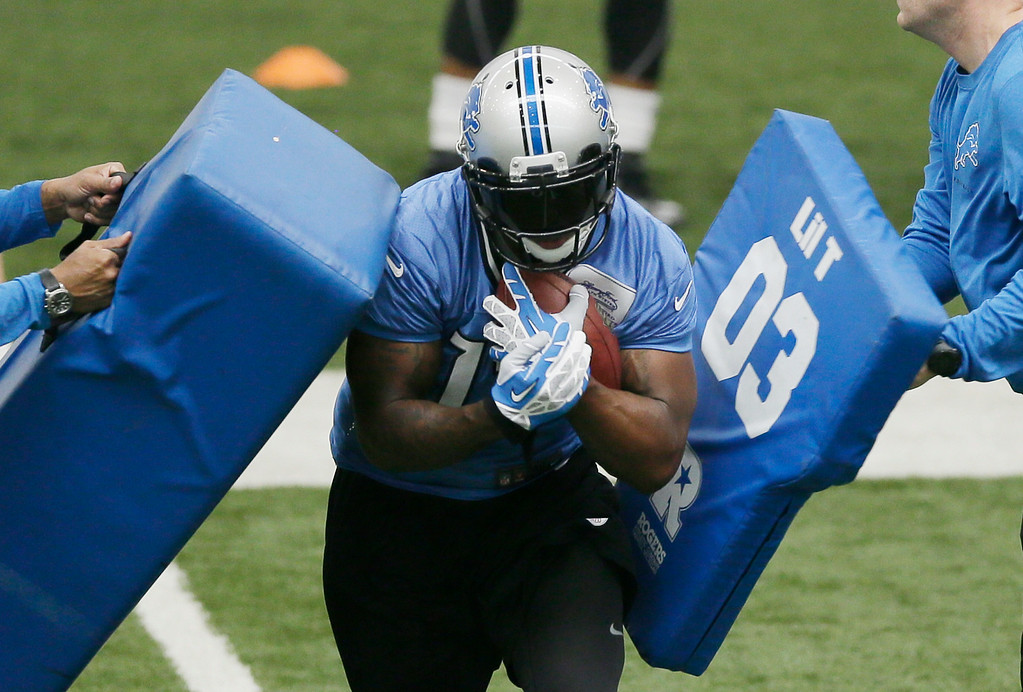 . Detroit Lions wide receiver Jeremy Ross runs through drills during the team\'s organized team activities at the Lions NFL football training camp facility in Allen Park, Mich., Wednesday, May 21, 2014. (AP Photo/Carlos Osorio)