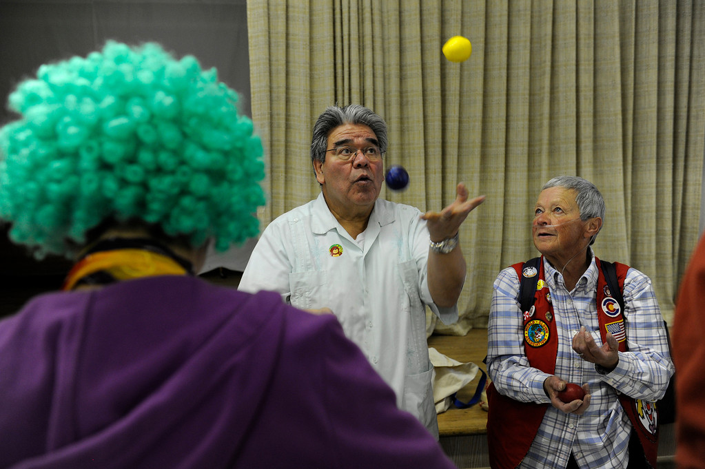 . Bernie Lopez teaches Fran Etzkorn the basics of juggling during Clown Class at First Presbyterian Church in Englewood on Sunday, February 17, 2013. The Colorado Clowns presented the 10-week series of classes that taught participants how to apply make up, character development, skits, parades and the history of clowning. Seth A. McConnell, YourHub