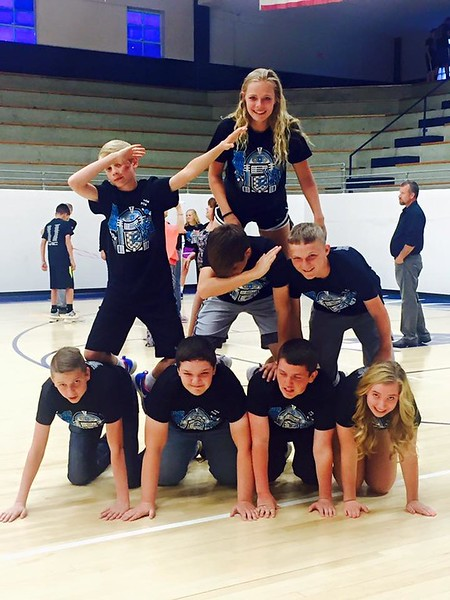 Preston Renz, Bryson Rupp, Lane Werth, Maggie Speno, Brandon Karlin, Ethan Brummer, Tyson Dinkel, and Jenna Romme celebrate   during the 2016 Eighth Grade Night.