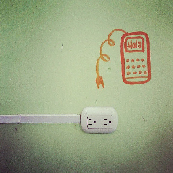 A_little_hole_in_the_wall_restaurant_in_Canoa_welcomes_you_to_charge_your_phone_while_eating..jpg