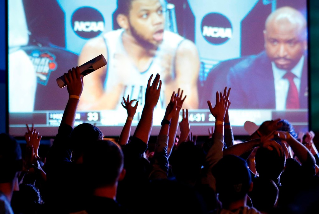 . Villanova fans cheer during the second half of the broadcast of the national NCAA college basketball championship between Villanova and Michigan, Monday, April 2, 2018, in Villanova, Pa. (AP Photo/Laurence Kesterson)