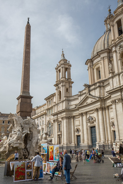 Selling art in Piazza Navona. The plaza sits on the site (and roughly maintains the shape of) the former Circus Agonalis, or Stadium of Domitian where athletic competitions were held starting around 80 AD.