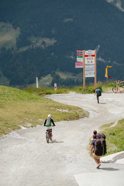 Mountain biker and paragliders in Verbier