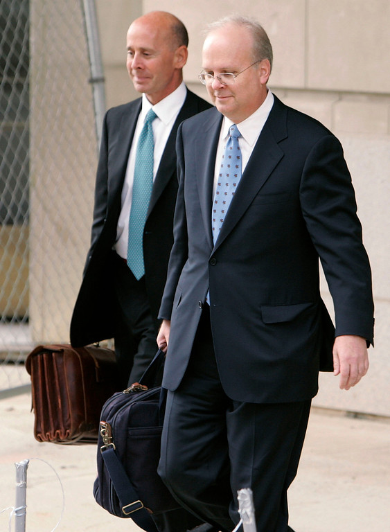 . WASHINGTON - OCTOBER 14:  White House Deputy Chief of Staff Karl Rove (R) emerges from U.S. District Court October 14, 2005 in Washington, DC. Rove appeared before a grand jury investigating the leak of covert CIA agent Valerie Plame\'s identity.  (Photo by Mark Wilson/Getty Images)