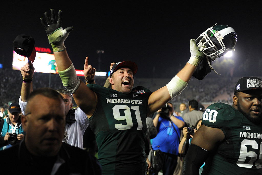 . Michigan State\'s Tyler Hoover celebrates after beating Stanford 24-20 at the Rose Bowl, Wednesday, January 1, 2014. (Photo by Michael Owen Baker/L.A. Daily News)