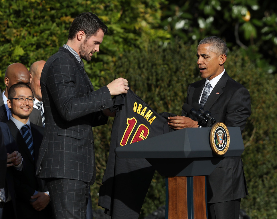 . Cleveland Cavaliers forward Kevin Love presents President Barack Obama with the team jersey during a ceremony honoring the 2016 NBA basketball champions, Thursday, Nov. 10, 2016, on the South Lawn of the White House in Washington. (AP Photo/Manuel Balce Ceneta)