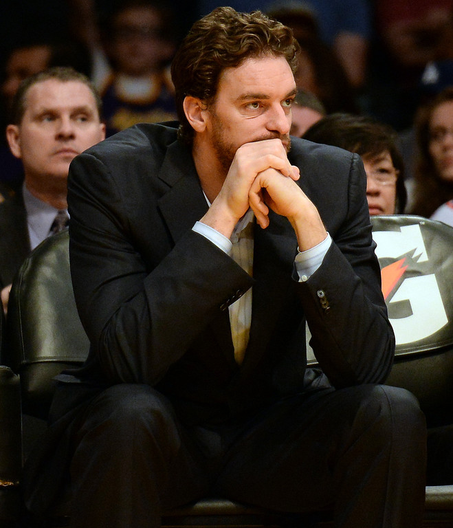 . Los Angeles Lakers\' Pau Gasol sits on the bench in the second half during an NBA basketball game against the Dallas Mavericks in Los Angeles, Calif., on Friday, April 4, 2014. Dallas Mavericks won 107-95.  (Keith Birmingham Pasadena Star-News)