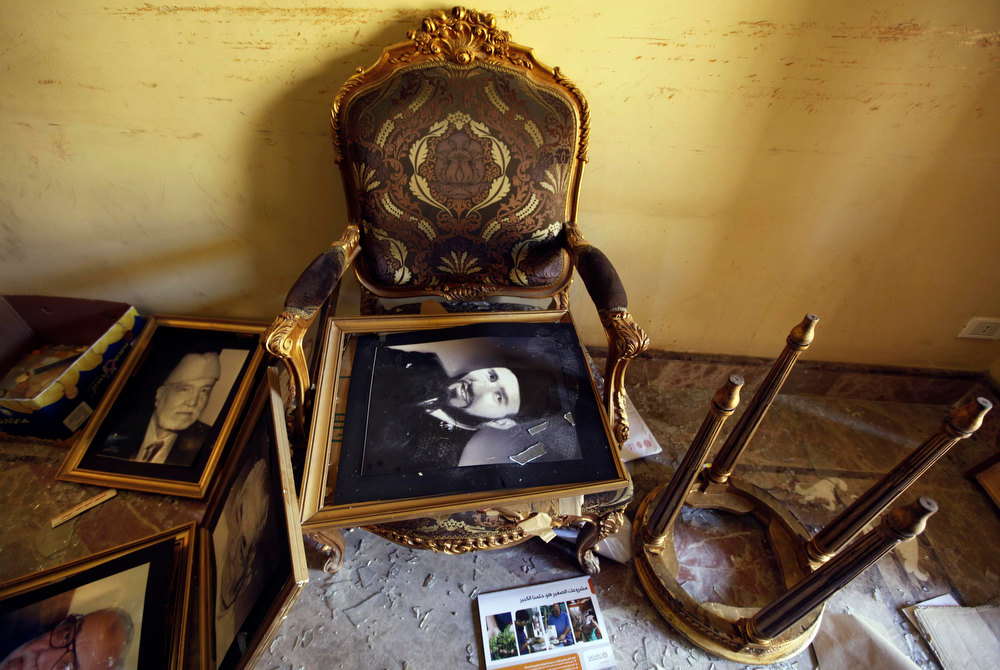 Description of . A framed portrait of Muslim Brotherhood founder Hassan Al-Banna lies on a chair in a ransacked room at the Muslim Brotherhood headquarters, which was attacked two days ago, in Cairo December 8, 2012. A senior Muslim Brotherhood official said on Saturday a statement by Egypt\'s military calling for dialogue was a welcome step in helping to end a political crisis that did not take sides.     REUTERS/Amr Abdallah Dalsh