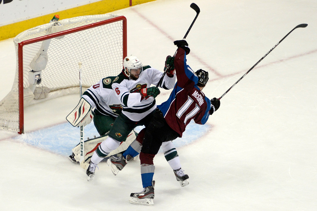 . Marco Scandella (6) of the Minnesota Wild checks Jamie McGinn (11) of the Colorado Avalanche in front of the net being defended by Ilya Bryzgalov (30) of the Minnesota Wild during the first period.  (Photo by AAron Ontiveroz/The Denver Post)