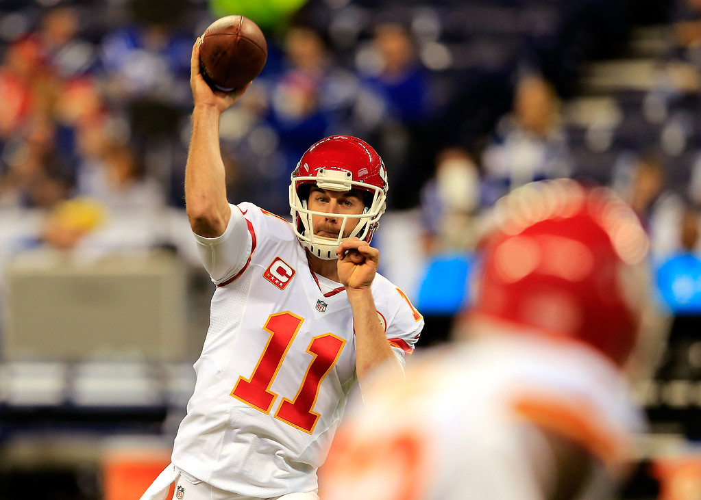 . INDIANAPOLIS, IN - JANUARY 04: Quarterback Alex Smith #11 of the Kansas City Chiefs warms up before a Wild Card Playoff game against the Indianapolis Colts at Lucas Oil Stadium on January 4, 2014 in Indianapolis, Indiana.  (Photo by Rob Carr/Getty Images)