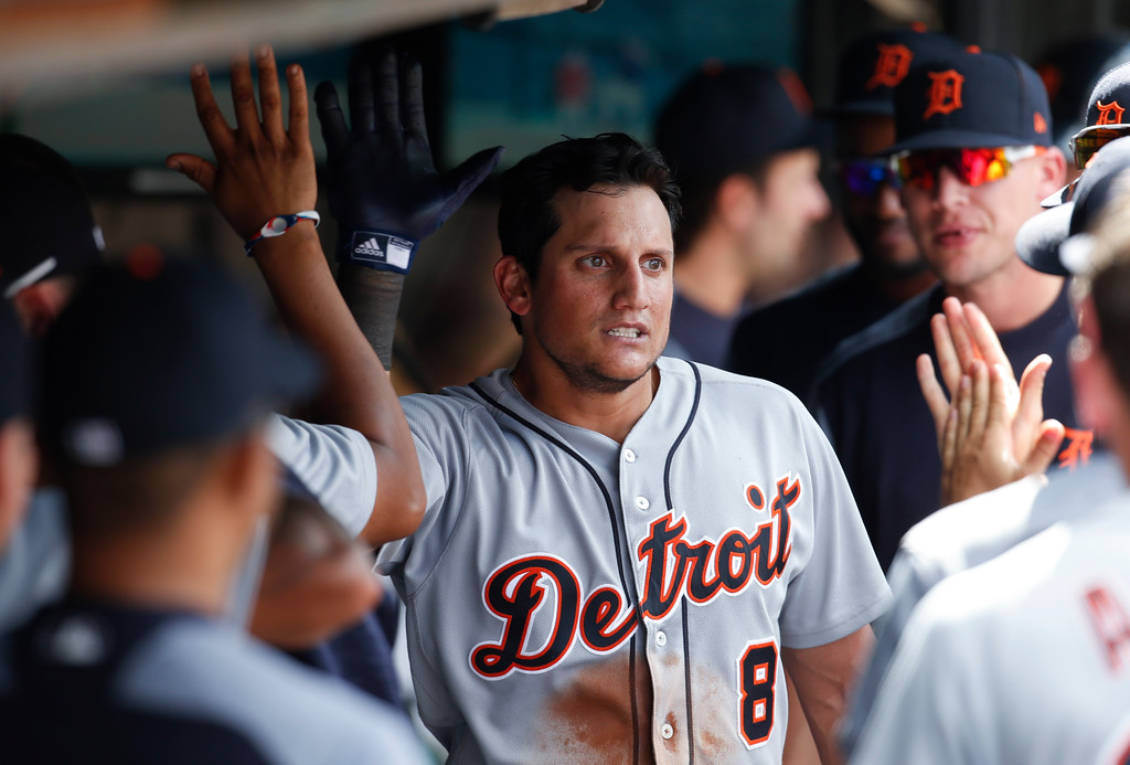 . Detroit Tigers\' Mikie Mahtook celebrates with teammates in the dugout after hitting a solo home run off Cleveland Indians\' Andrew Miller during the eighth inning of a baseball game, Sunday, Sept. 16, 2018, in Cleveland. (AP Photo/Ron Schwane)