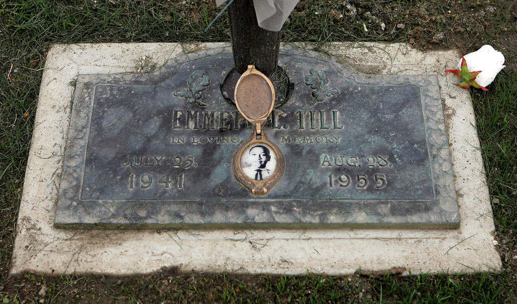. A photo of Emmett Till, a black Chicago teenager who was slain in rural Mississippi in 1955 for supposedly whistling at a white woman, is shown on his grave marker Friday, Aug. 26, 2005, in Alsip, Ill. Sunday marks the 50th anniversary of the race killing that sparked the civil rights movement. Till, who was from Chicago, was abducted from his uncle\'s Mississippi home on Aug. 28, 1955 during a summer visit. Fishermen found his disfigured body three days later in the Tallahatchie River. (AP Photo/M. Spencer Green)