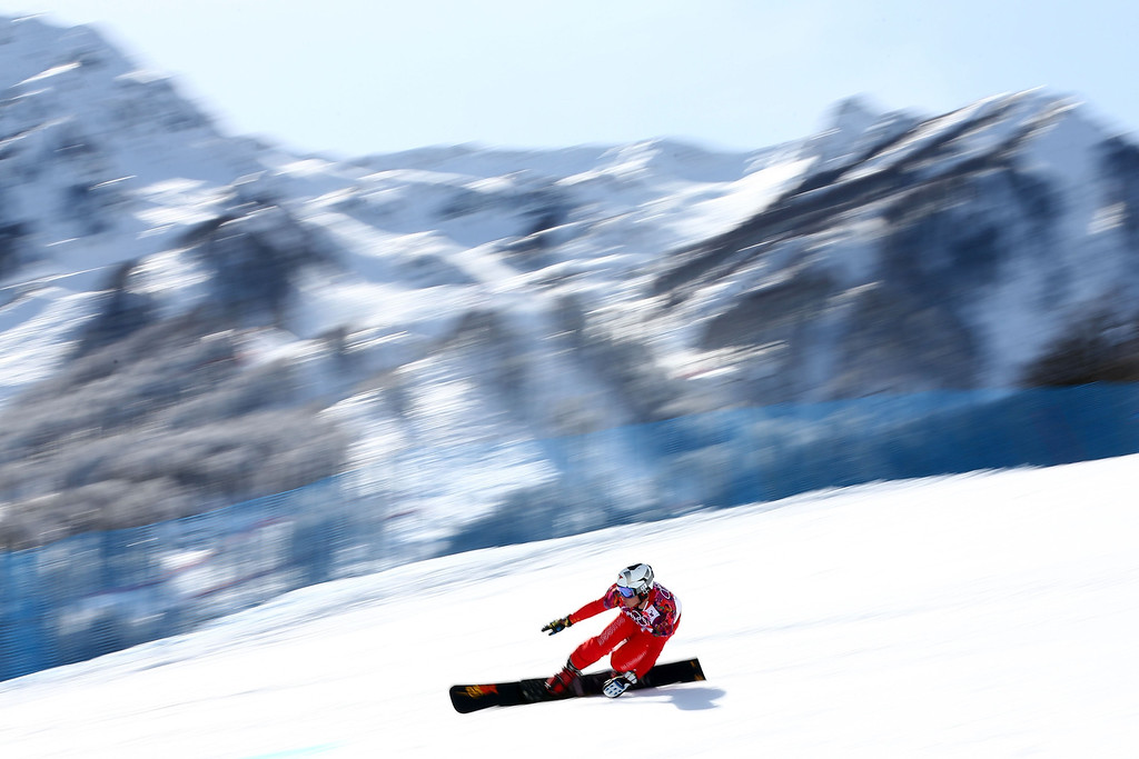 . SOCHI, RUSSIA - FEBRUARY 19:  Nevin Galmarini of Switzerland competes in the Snowboard Men\'s Parallel Giant Slalom Quarterfinals on day twelve of the 2014 Winter Olympics at Rosa Khutor Extreme Park on February 19, 2014 in Sochi, Russia.  (Photo by Cameron Spencer/Getty Images)