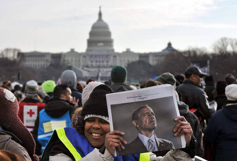 . A vendor sells newspapers at the 57th Presidential Inauguration on January 21, 2013. US President Barack Obama was sworn in for a second term. MLADEN ANTONOV/AFP/Getty Images