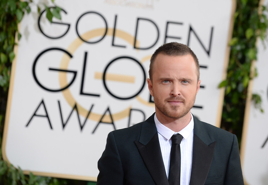 . Aaron Paul arrives at the 71st annual Golden Globe Awards at the Beverly Hilton Hotel on Sunday, Jan. 12, 2014, in Beverly Hills, Calif. (Photo by Jordan Strauss/Invision/AP)