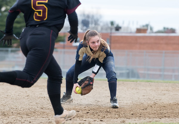 04/11/19 Wesley Bunnell | Staff New Britain softball defeated Newington on the road 4-1 on Thursday afternoon. Newington Julia Szwez (1) fields and tosses to first for the out.