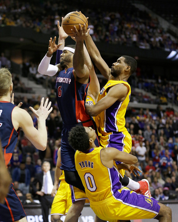 . Detroit Pistons forward Josh Smith (6) is charged with an offensive foul on Los Angeles Lakers  forward Nick Young (0) during the closing seconds of their NBA basketball game at the Palace in Auburn Hills, Mich., Friday, Nov. 29, 2013. (AP Photo/Carlos Osorio)