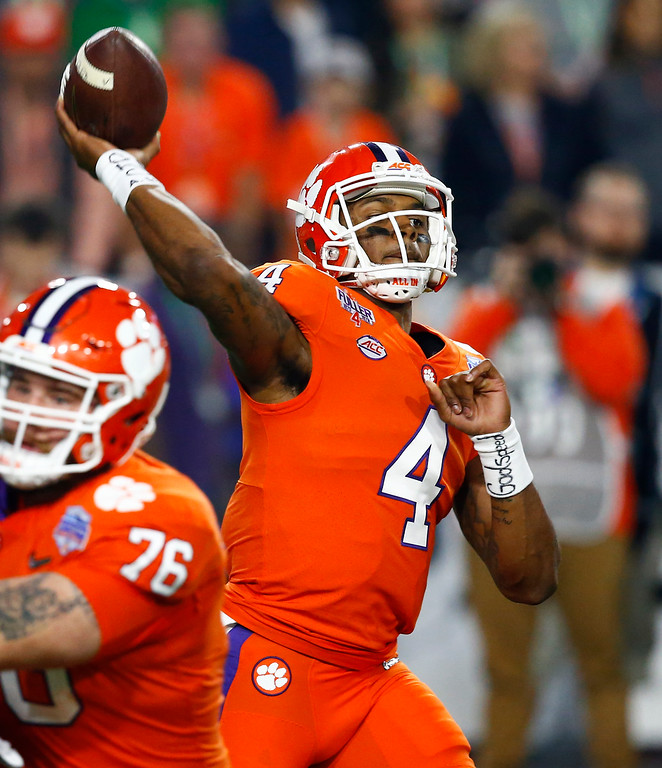 . Clemson quarterback Deshaun Watson (4) throws against Ohio State during the first half of the Fiesta Bowl NCAA college football playoff semifinal, Saturday, Dec. 31, 2016, in Glendale, Ariz. (AP Photo/Ross D. Franklin)