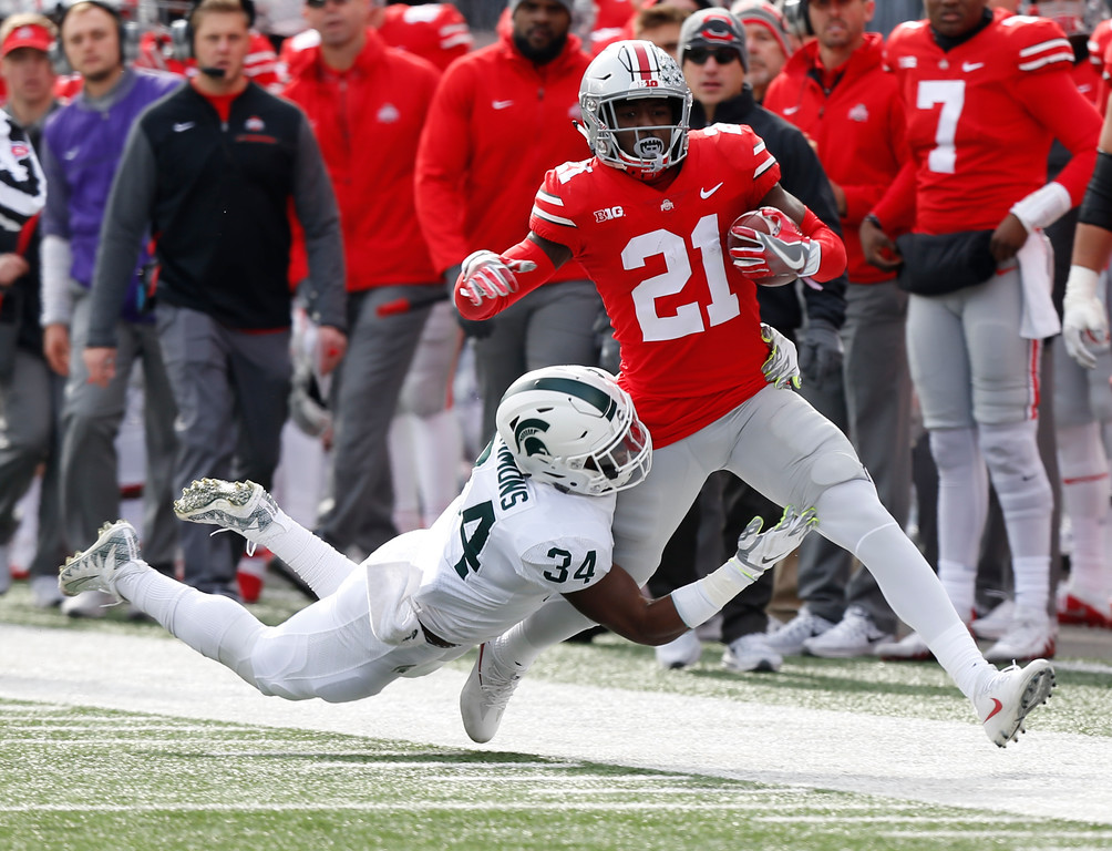 . Michigan State linebacker Antjuan Simmons, left, forces Ohio State receiver Parris Campbell out of bounds during the first half of an NCAA college football game Saturday, Nov. 11, 2017, in Columbus, Ohio. (AP Photo/Jay LaPrete)
