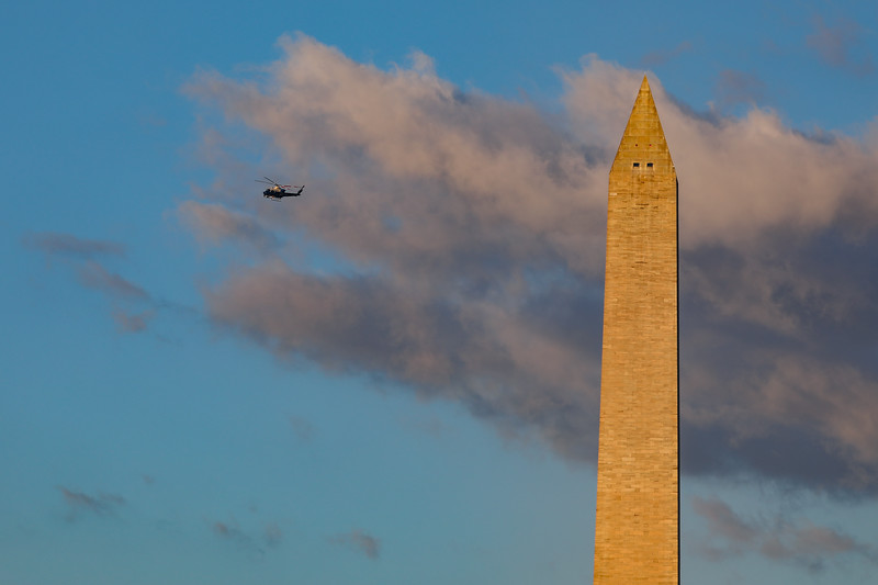 Police helicopter flies over the Washington Monument on inauguration day